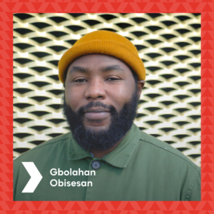 Photograph of Gbolahan Obisesan in front of the Brixton House gold ventilation wall