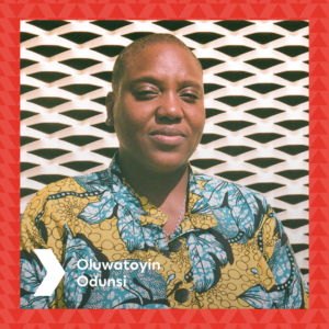 Photograph of Oluwatoyin Odunsi in front of the Brixton House gold ventilation wall