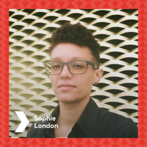 Photograph of Sophie London in front of the Brixton House gold ventilation wall